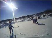 Pond hockey from a helmet camera