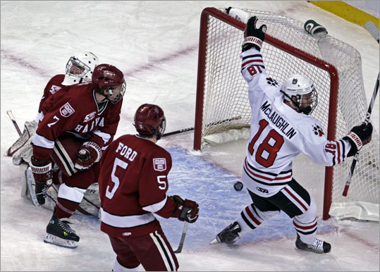 Northeastern 4, Harvard 0 Northeastern's Mike McLaughlin beat Harvard goalie Ryan Carroll to give Northeastern a 1-0 lead in the first period.