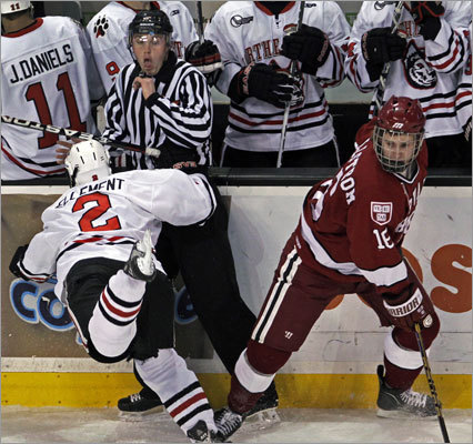 Northeastern 4, Harvard 0 An official braced for a possible hit from Northeastern's Drew Ellement after Harvard's Alex Fallstrom (right) avoided him in the first period.