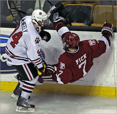 Northeastern 4, Harvard 0 Northeastern's Tyler McNeely (left) dumped the Crimson's Danny Fick in the third period.