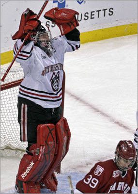 Northeastern 4, Harvard 0 Northeastern goalie Chris Rawlings raised his arms in triumph while Harvard's Pier-Olivier Michaud skated away after the clock ran out on the Huskies' 4-0 victory in the opening game of the 2011 Beanpot Tournament at TD Garden.
