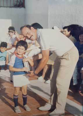 ''That's all we've known,'' said Edgar Gonzalez, the middle of the three brothers and a former teammate of Adrian's on the Padres. ''All our conversations were usually baseball when we were young. It was all about baseball ... that was our whole life.'' Pictured: Adrian, as a boy, received a trophy from his father after winning a tournament in Tijuana, Mexico.