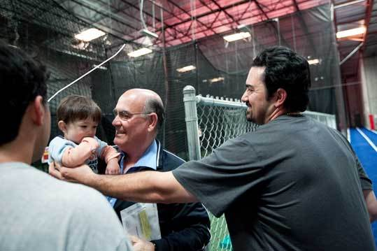 It's too early to tell the baseball skills of Adrian's one-and-a-half-year-old nephew, Mateo, held by Adrian's father David, but he's certainly got the baseball genes.