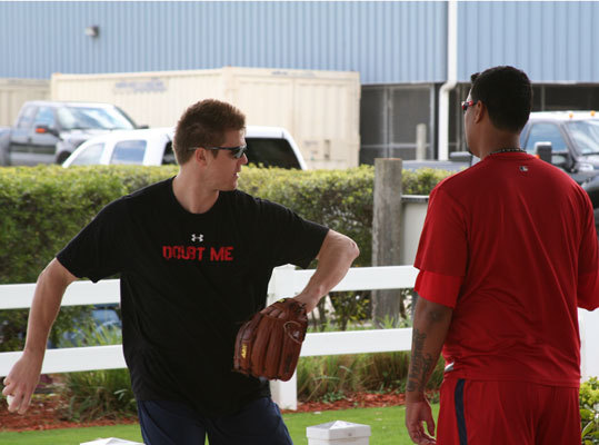 Jonathan Papelbon took time out on Tuesday to share some throwing tips before heading out to the bullpen to work on his own throwing motion. Papelbon's t-shirt read 'DOUBT ME' on the front, perhaps sending a message to anyone who may have lost confidence in the Red Sox closer.