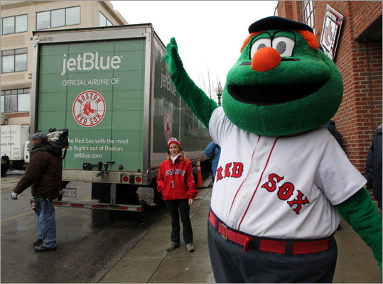 Wally waves to the crows as the Red Sox equipment truck was packed up at Fenway Park, leaving for spring training in Fort Myers, Fla., today.