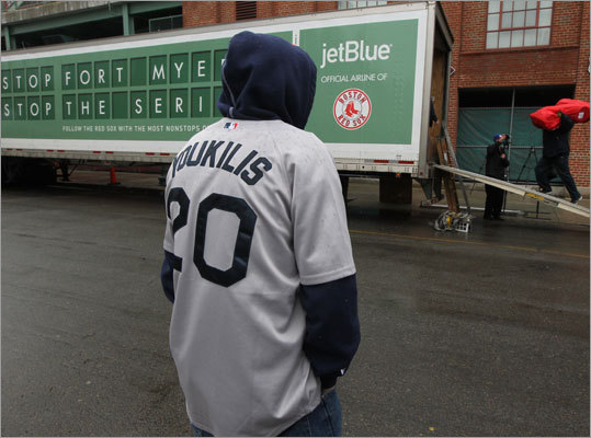 Jason Cappuccio of Everett watches the Red Sox equipment truck get packed up.