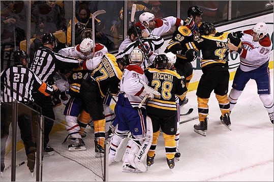 It was fight night between the Bruins and the Canadiens as multiple fights broke out throughout the game. The fight pictured at left occurred during the third period. Among the fights, Nathan Horton and P.K. Subban went at each other all night. Andrew Ference threw down with Travis Moen. Johnny Boychuk repeatedly cuffed Jaroslav Spacek. Gregory Campbell fed Tom Pyatt with a string of lefts. Benoit Pouliot decked David Krejci with a right hand that had the Bruins center icing his lower lip after the game.