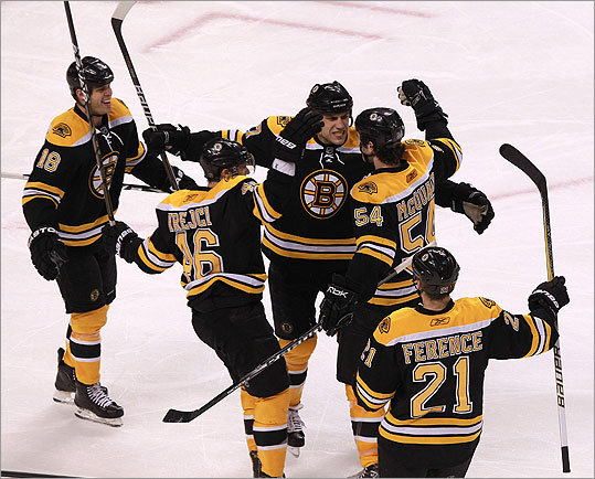 Bruins left wing Milan Lucic (17) celebrated with teammates after his second goal in the second period.