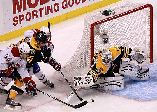Bruins goalie Tim Thomas (30) made a pad save as he was pressured by Montreal during the first period.