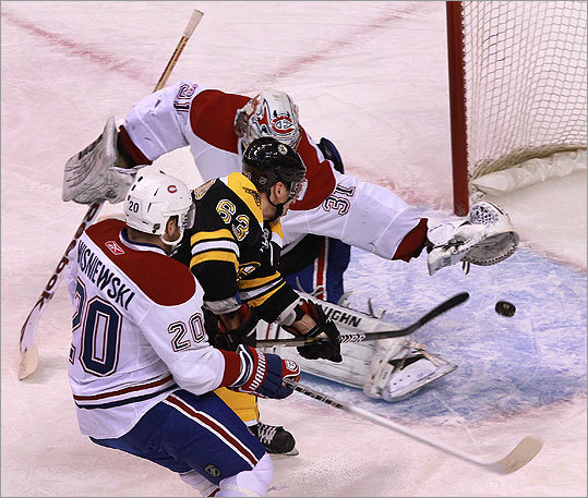 Bruins left wing Brad Marchand (63) put the Bruins up 1-0 on this goal as he beat Canadiens goalie Carey Price (31) during the first period.