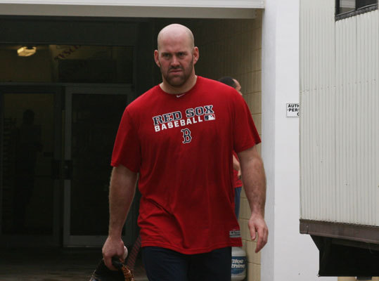 Kevin Youkilis was back in camp on a rainy Friday morning. The Red Sox third baseman played catch in the cages with newly acquired first baseman Adrian Gonzalez.