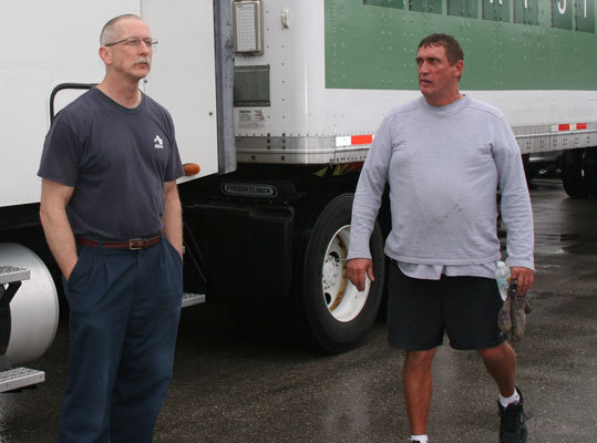 Driver Al Hartz (left) said the ride down Rte. 95 south from Boston to Fort Myers was uneventful, just the way he likes it. Hartz had to wait for a few cars to be moved before the truck was able to make it to the back of the complex for the unloading festivities.