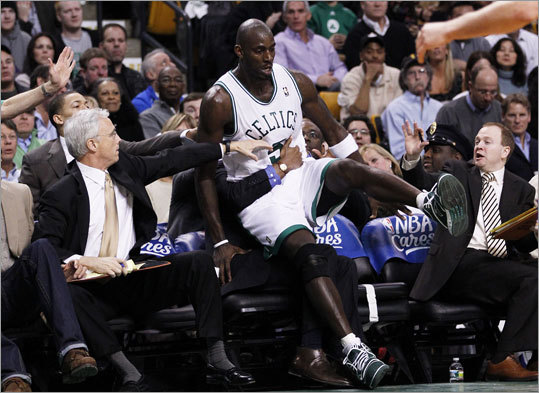 Kevin Garnett fell into the bench after chasing down a loose ball in the third quarter.