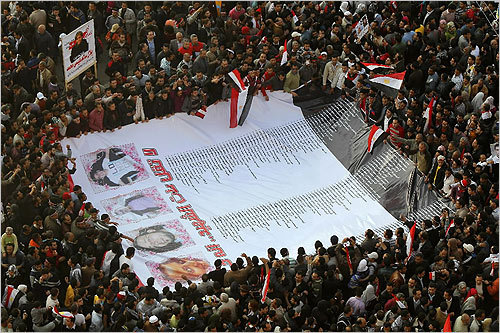 Protesters carried a huge banner with names and pictures of victims killed during protests at Cairo's Tahrir Square on Friday.