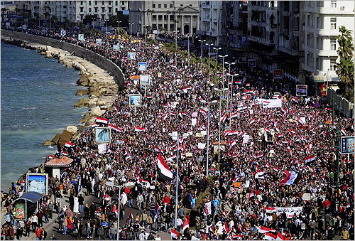 After 18 days of protests in Egypt, President Hosni Mubarak has stepped down, Vice President Omar Suleiman announced on Friday. On Thursday, Mubarak had announced he would not resign. On Friday, he reportedly left the city for a Red Sea resort as Egyptians stationed themselves outside the presidential palace and the State TV building. Read on to see scenes from the latest events in Egypt. In this photo, Egyptian antigovernment protesters marched in the coastal city of Alexandria on Friday.