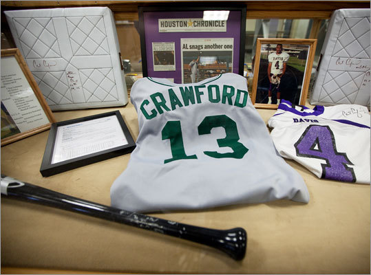 A display case in the library at Jefferson Davis Senior high school, Crawford's old stomping ground, has his old jersey as well as other memorabilia of the new Red Sox outfielder.