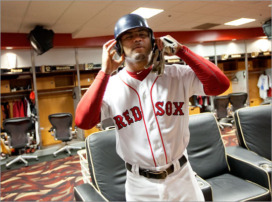 Crawford put on a Red Sox uniform in the Houston Astros locker room before doing a photo shoot for ESPN.