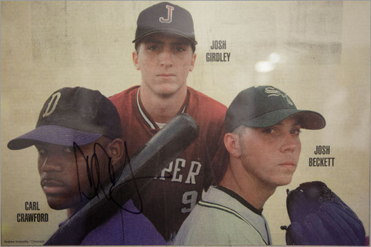 Inside of Principal Jaime Casteñeda's office at Jefferson Davis Senior high school (Crawford's former school), a 1999 copy of the Houston Chronicle features a photo of native Texan Red Sox players Crawford and Josh Beckett.