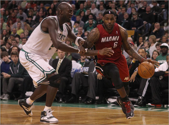 The Boston Celtics beat the Miami Heat 85-82 Sunday afternoon to recapture the lead in the Eastern Conference Standings. Kevin Garnett led the Celtics with 19 points and seven rebounds. Here, Garnett defends Miami's LeBron James as he drives to the basket during second quarter action at TD Garden.