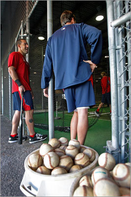 Ryan Kalish (left), who chatted with hitting coach Dave Magadan (right) while waiting his turn in a batting cage.