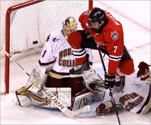 Boston College 7, Northeastern 6 Northeastern defenseman Anthony Bitetto (7) leaped in front of Boston College goaltender John Muse on a power-play goal by Brodie Reid that put Northeastern up 2-1