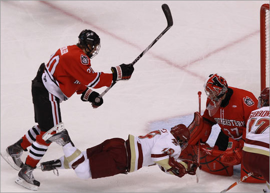 Boston College 7, Northeastern 6 Boston College's Joe Whitney (15) took a diving shot at Northeastern goalie Chris Rawlings (37) during the first period.