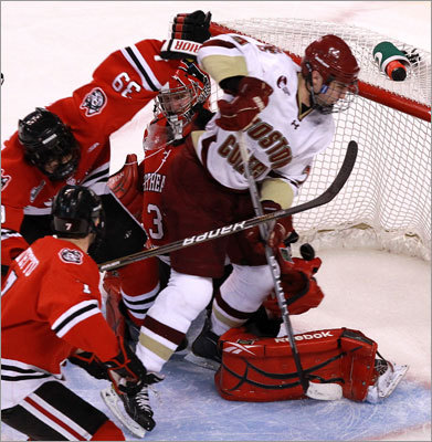 Boston College 7, Northeastern 6 Joe Whitney (right) put Boston College up 6-5 late in the third period when his shot bounced past Northeastern goalie Chris Rawlings.