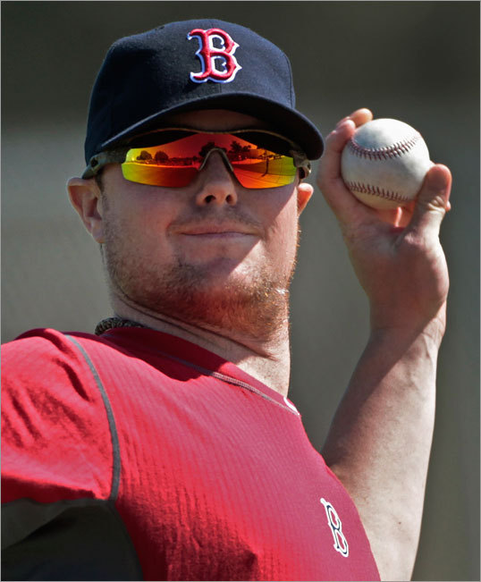 Red Sox starter Jon Lester warmed up on the first official day of spring training. Lester is expected to compete for the AL Cy Young Award this season.