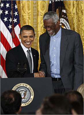 During a ceremony Tuesday at the White House, Obama said the recipients represent, 'the best of who we are and who we aspire to be.' At right, the president congratulated basketball great Bill Russell during the ceremony.