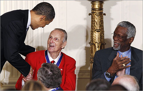 Obama shook hands with baseball legend Stan Musial as Russell looked on during the ceremony.