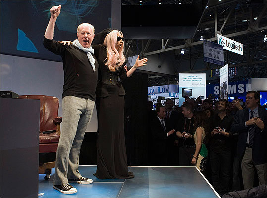 The black Lapointe dress the Lady Gaga wore to the Consumer Electronics show came from the designer's spring collection, which was based on the idea of going mad. Pictured: Lady Gaga in Lapointe's dress as Polaroid Chairman Bobby Sager introduced her Grey Label products during the Consumer Electronics Show in Las Vegas.