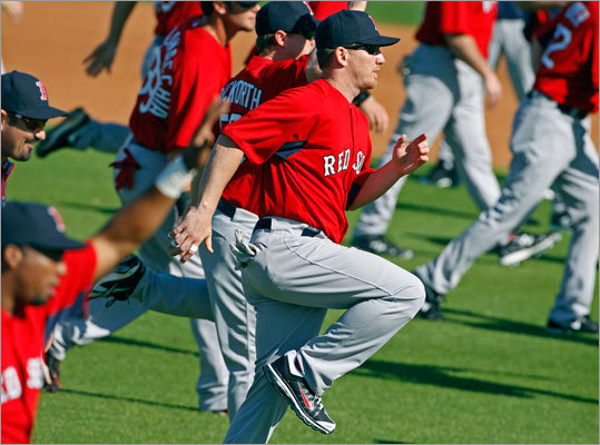 On his first day in camp, Red Sox outfielder J.D. Drew took part in the morning exercise routine Saturday.