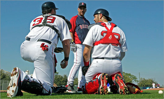 Red Sox manager Terry Francona (center) will be watching the development of catcher Jarrod Saltalamacchia (left), as will his backup Jason Varitek (right).