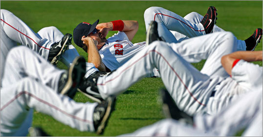 Red Sox catcher Jason Varitek worked his abs along with his teammates on Sunday.
