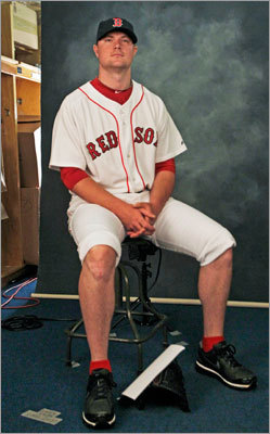 Good thing it was only a head shot. Jon Lester rolled up his uniform pants while taping a promotional spot.