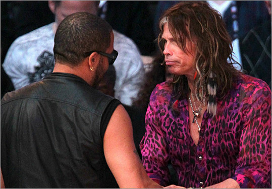 Musicians Lenny Kravitz, left, and Steven Tyler shook hands at the NBA All-Star game.