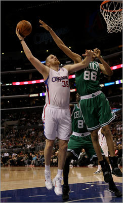 Chris Johnson, who was signed to a 10-day contract to help fill the void left by the players the Celtics traded away for draft picks, matched up with Chris Kaman.