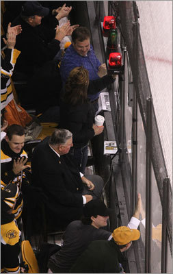 Ed Quin has been lighting the lamp for the last 26 years of a 40-year career officiating sports. During a Bruins game, he sat stoically in the first row on a bar chair in the aisle of TD Garden, his thumb on a trigger, a telephone at his feet. When a goal is scored, he holds the button down and counts to 10 — especially if it's a Bruins goal.