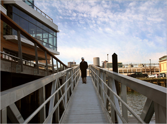 Pictured here is developer William G. Curtis V, who worked on the Liberty Wharf project, standing on a ramp that leads to moorings for boats. The developer also said that it took around a year to build the foundation for the Liberty Wharf. The history of the site goes back much further, however. Read on for a look at the history of the development, from it's former incarnation as Jimmy's Harborside through the redevelopment process.