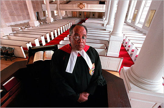 In this photo taken in 2000, Reverend Peter Gomes was at the pulpit of Memorial Church at Harvard University.