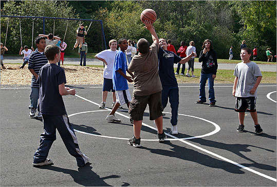 Holbrook Irish population: 42.2% Incorporated in 1640, the town of Holbrook now has about 10,000 residents. At left, children enjoy recess at Holbrook's South Elementary School. Margin of error: +/-8.2%