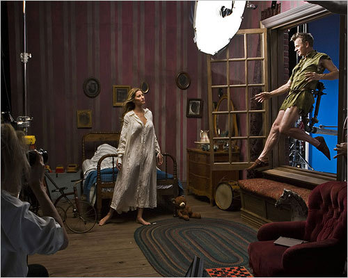 The series launched in 2007 and has included celebrities such as star soccer player David Beckham and actresses Scarlett Johansson and Julianne Moore. In this portrait released in 2008, from left, supermodel Gisele Bundchen, portraying Wendy Darling, and dance legend Mikhail Baryshnikov, as Peter Pan, posed in a scene from 'Peter Pan.' Leibovitz can be seen on the side.