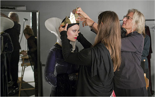 In this handout image provided by Disney Parks, actress and model Olivia Wilde portrayed the Evil Queen from 'Snow White and the Seven Dwarfs' as Leibovitz fixed her costume.