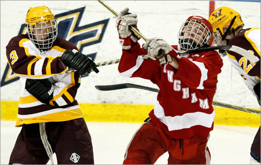 Weymouth's Riley Flanagan (3) gets his stick around the neck of Hingham's Tim Driscoll during the first round of the MIAA Super 8 hockey tournament in North Andover Saturday, March 5, 2011. Weymouth beat Hingham, the defending Super 8 champions, 4-3 with Flanagan scoring the game-tying goal and assisting on the game-winner.