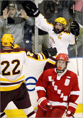 Weymouth's Trevor King celebrated his game-winning goal in the third period with teammate Andy Sheridan (22) as Hingham's Ryan Linehan skated away.