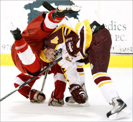 Weymouth's Pat Walsh (4) flipped Hingham's Tim Driscoll in the third period of Weymouth's 4-3 win over the Harbormen.
