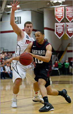 Harvard's Brandyn Curry drove to the basket with defensive pressure from Princeton's Dan Mavraides in the second half.