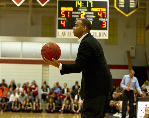 Harvard head coach Tommy Amaker held the game ball in the second half with his team leading 51-47.