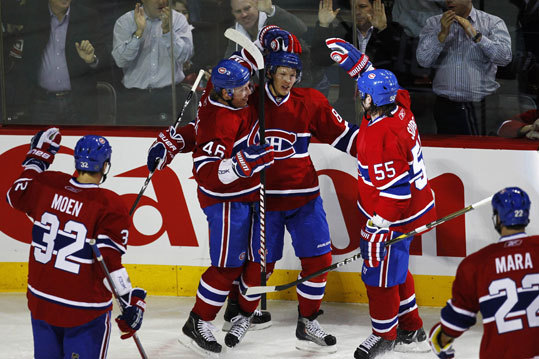 Canadiens Travis Moen, Andrei Kostitsyn, Lars Eller, Brent Sopel and Paul Mara (left to right) celebrated one of Eller's two goals in the first period