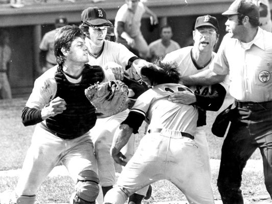 Carlton Fisk The Red Sox catcher had more than one home-plate collision with his rival from the Yankees, Thurman Munson. But one, at Fenway Park in 1973, touched off a bench-clearing donnybrook. Munson barreled into Fisk on a botched squeeze play, and when Fisk shoved Munson off him after making the out, Munson punched Fisk, setting in motion a full-scale rhubarb. Fisk had more than his share of collisions at the plate. In June 1974, he suffered a season-ending knee injury after Cleveland's Leron Lee crashed into him.